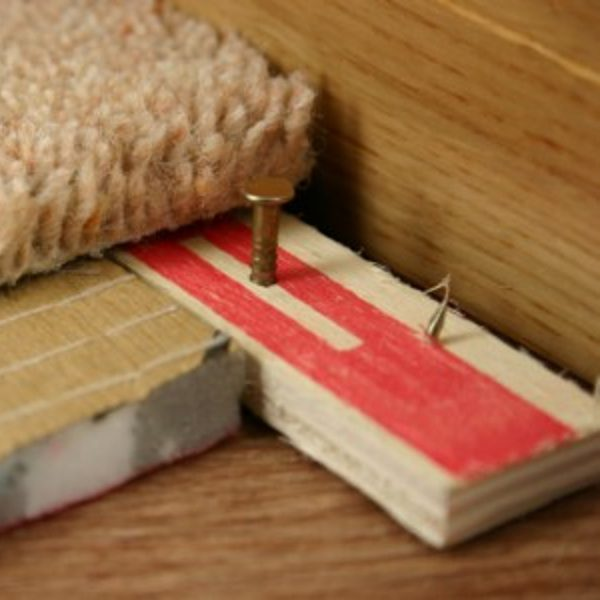 Closeup of how to use carpet gripper and underlay